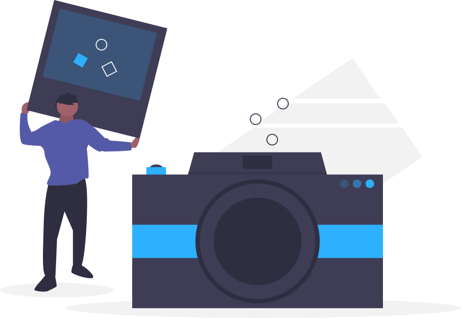Homem segurando um retrato ao lado de uma maquina fotográfica